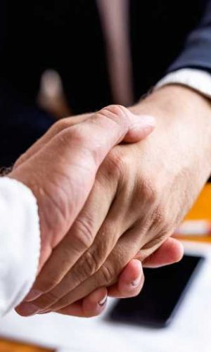 bigstock-Businessman-Handshake-Close-Up-379088089 (1)